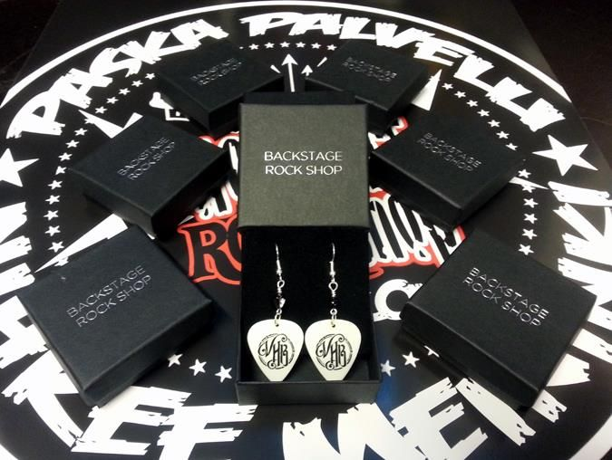 White Logo Earrings - Von Hertzen Brothers. Designed and made by Jaana Bragge.