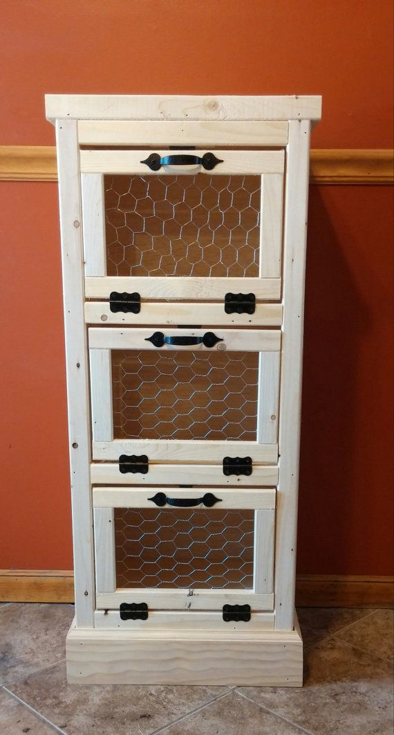 3 Door Vegetable Bin-make this as a built in in the root cellar (or kitchen wall) to save space.  Have removable boxes inside for easy cleaning if a spud or onion go south and make a mess.