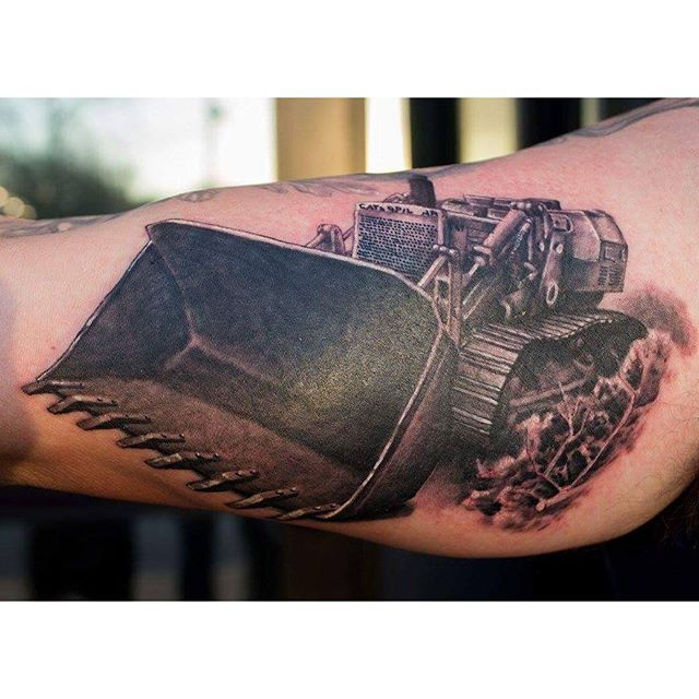heavy equipment tattoo of a bulldozer done by john kautz