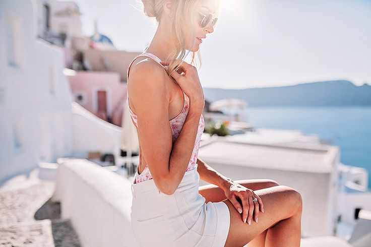 Summer outfit on Santorini with a pink open-back swimsuit and high-waisted shorts - Anna Pauliina, Arctic Vanilla blog.