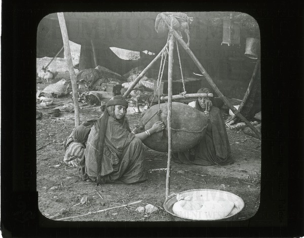 Bedouin women churning milk, Palestine, Asia | saskhistoryonline.ca