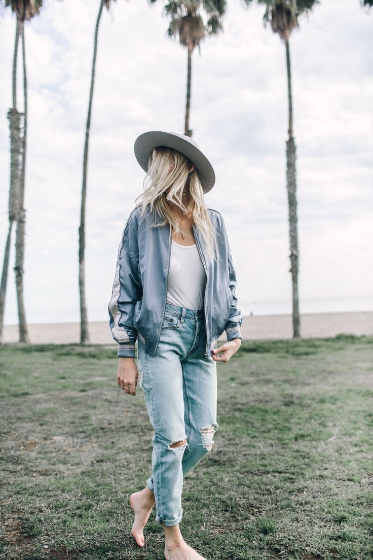 Pair washed out denim with a bomber jacket for a vintage athletic look.