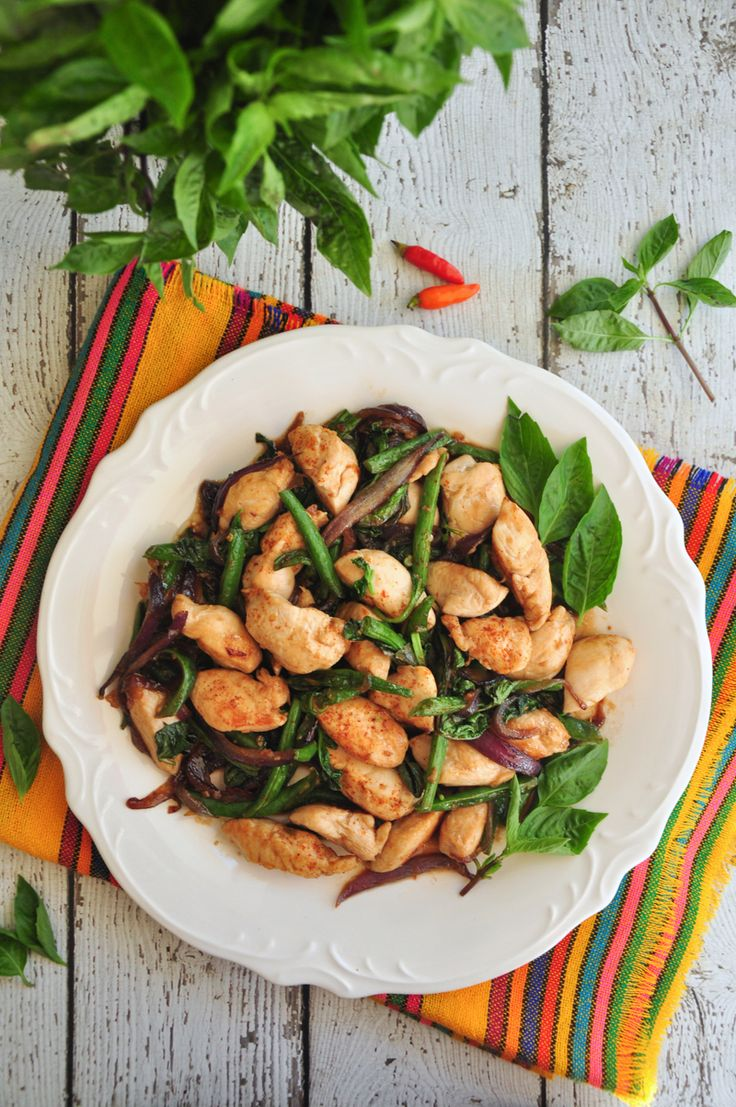 An authentic Thai sautéed chicken with tons of fresh basil leaves that's ready in just 20 minutes. It goes extremely well with rice.