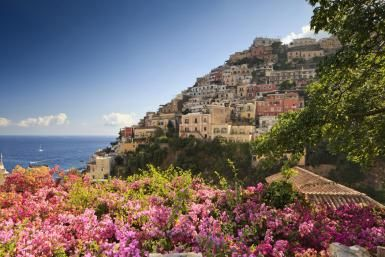 Positano, Italy photo, Bougainvilleas flowers, mediterranean area, Amalfi Coast - Slow Images/The Image Bank/Getty Images