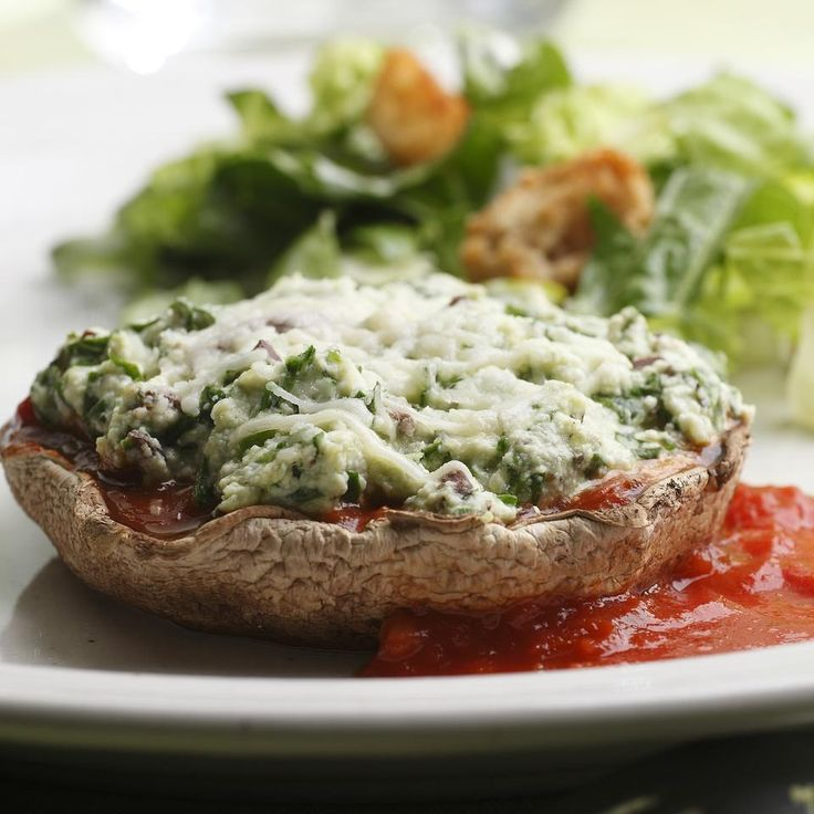 Here we take the elements of a vegetarian lasagna filling—ricotta, spinach and Parmesan cheese—and nestle them into roasted portobello mushroom caps.