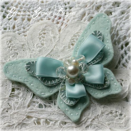 """I love this idea to add to the wedding dress or as part of the veil...for """"something blue"""" and I LOVE  butterflies...so this is perfect! :) ribbon & felt butterfly"""
