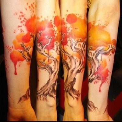 Fall colored tree watercolor tattoo on arm for girl, man this one is amazing