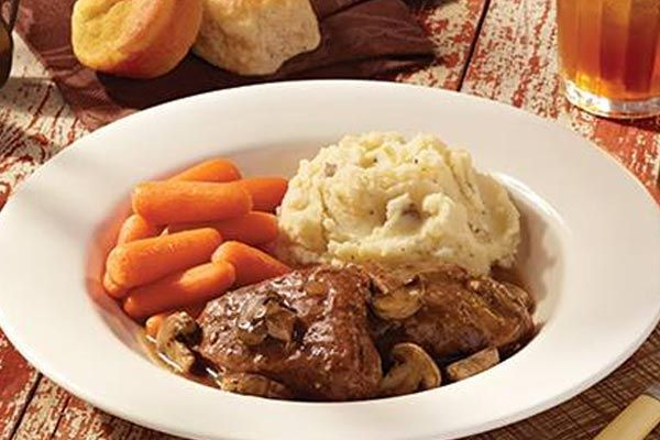 {Cracker Barrel(™) Mushroom Braised Pot Roast} I have a secret recipe for a flavorful pot roast served at Cracker Barrel. Cracker Barrel is well-known for their home-style dishes and with this recipe you can enjoy this classic dish at home. This fork-tender beef dish is topped with fresh sliced mushrooms and then slow-cooked in the oven or in a crockpot.