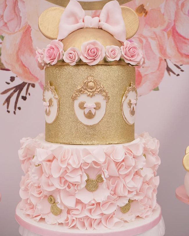 Pink and Gold Minnie Mouse First Birthday Party Cake on Pretty My Party #minniemousecake #minniemouse #minniemousepartyideas #minniemousebirthdaycake #minniemousebirthdayideas