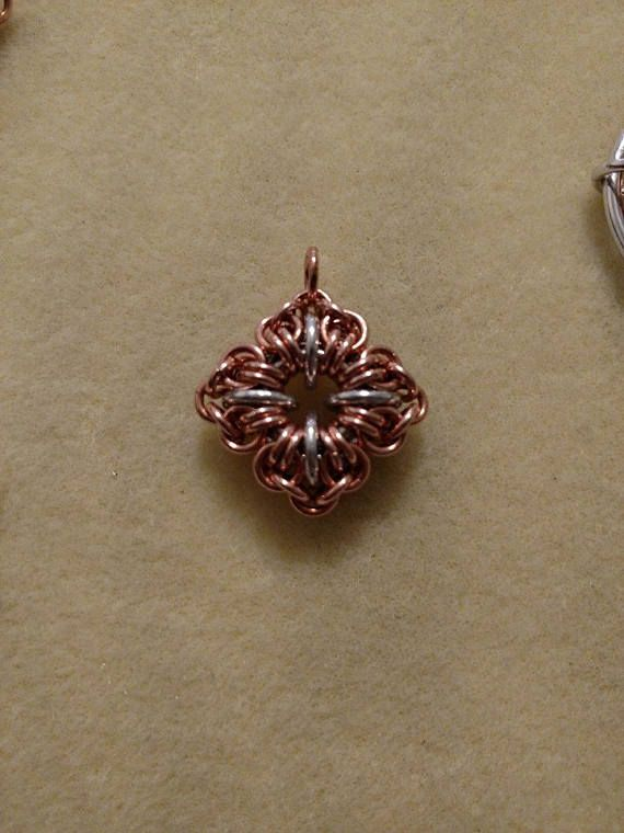 Tutorial to make all three variations of the Star Crossed chainmaille pendant. This tutorial is made using rings from C&T Designs.