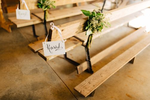 Aisle markers of greens and pretty hanging signs for Wedding Ceremony.