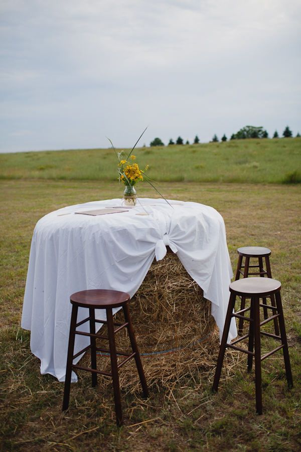 Big round hay-bales turned on their side (outdoor reception idea) And you can put a umbrella in middle of table to match wedding colors