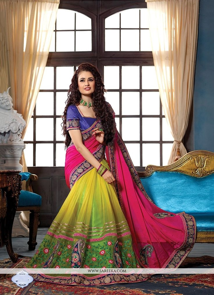 Designed with simplicity with a touch of soberness in its work makes a masterpiece. Add richer looks to your persona in this majestic green net and pure chiffon designer traditional sarees. This beaut...