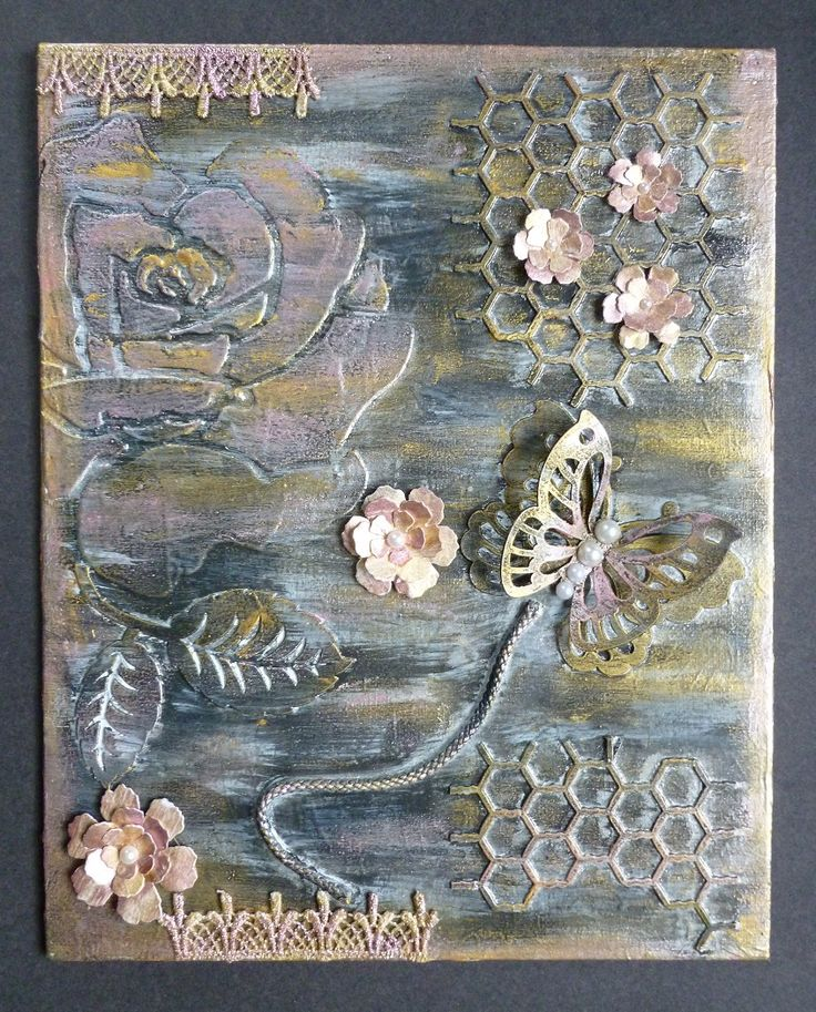 "'Butterfly and Flowers Canvas.  -  Imagination Craft's 8""x10"" Canvas.  Stencil Medium.  Black & White Gesso.  Silver, Dried rose and Gold Starlight paints.  Large rose stencil.  Metal spatula.  Butterfly & leaf Art Cutz.  Rich gold,  Inca gold & Sherbert Alchemy Waxes.  T.H. Flower dies.  Lace.  Pearls.  Black cord.  April 2016."