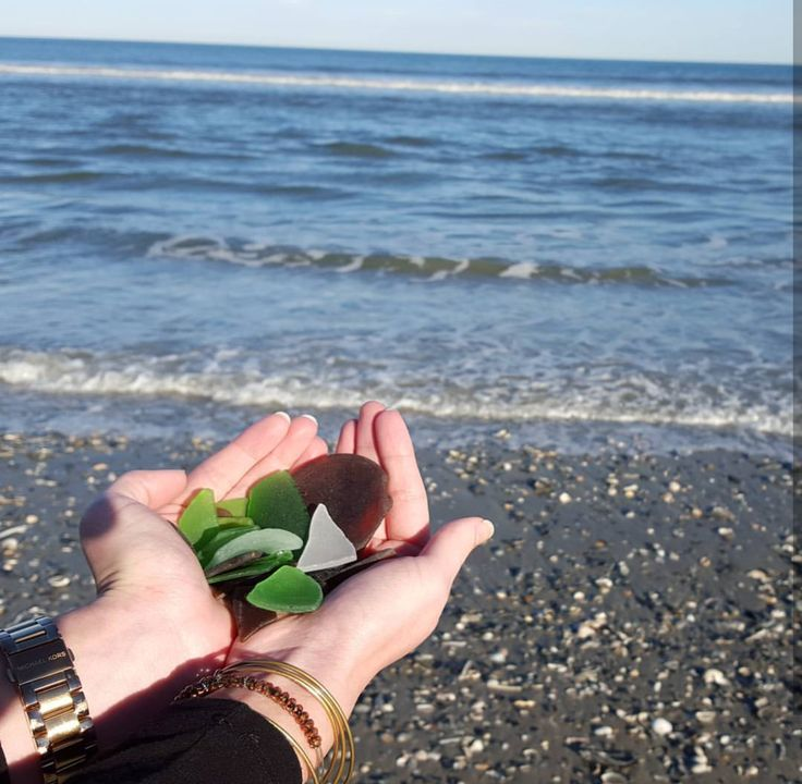Who loves searching for beach glass during their Outer Banks vacation? | Beach Combing - Corolla - Sea Glass - OBX