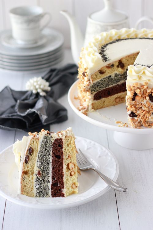Royal Layer Cake- 4 cakes in one! Peanut Layer, Chocolate Layer, Raisin Layer, and Poppy Seed Layer, with a Cream Cheese-Condensed Milk Frosting.