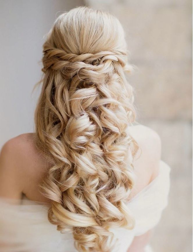 Simple, elegant braided wedding hairstyle with loose curls