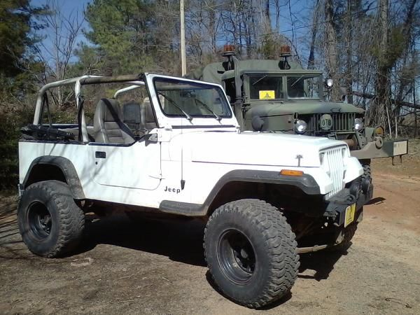 my 1995 jeep wrangler with the top down. Its amazing how much different it is to ride with everything thing on vs everything off. the top is kinda a pain to get off the older model jeeps but the newer ones from around 2000 and up are a lot easier but its worth the hassle.