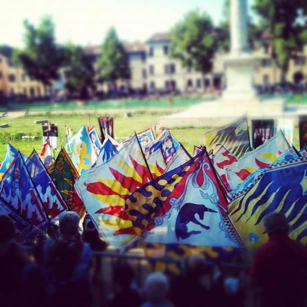 """Flags power at Piazza Ariostea for Palio di Ferrara"" - Instagram by @n_montemaggi - Great shot, Nicholas! #blogville"