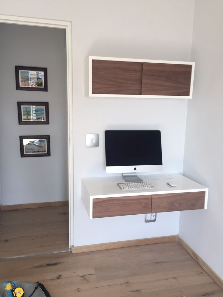 ODE home office with floating desk and floating box with sliding doors. This is white duco and walnut, order at ODE in a variety of finishes.
