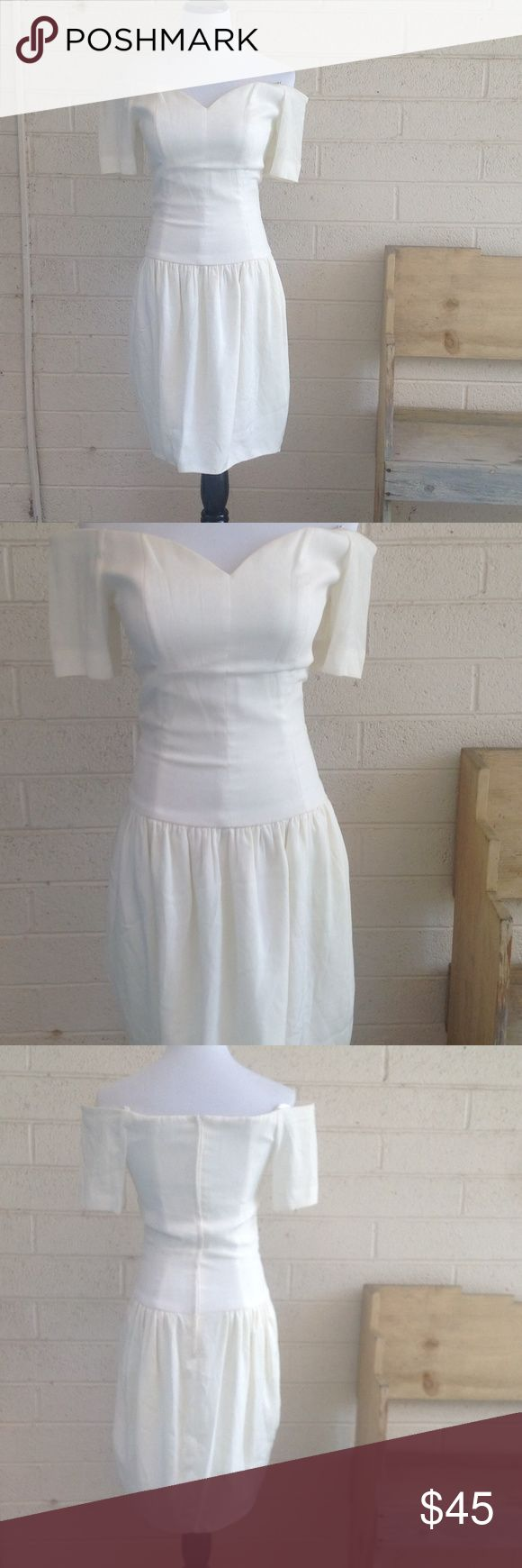 "Vintage Nicole Miller Cream Dress in size 8 Gently worn vintage Nicole Miller cocktail dress in cream. Classic vintage style! Sweetheart neckline with dropped waist. Sleeves are off the shoulder with wire inserts to make them ""poof"". Has lining throughout dress. Perfect for wedding season or prom! Nicole Miller Dresses Midi"