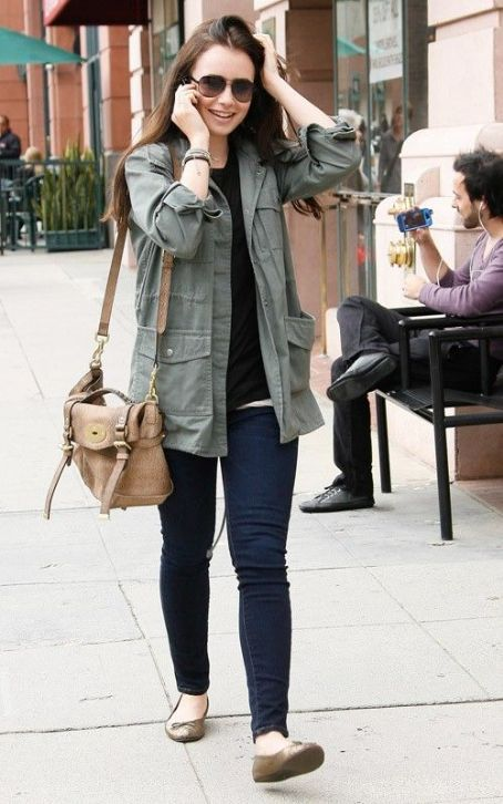 Casual in an army jacket and skinny jeans.