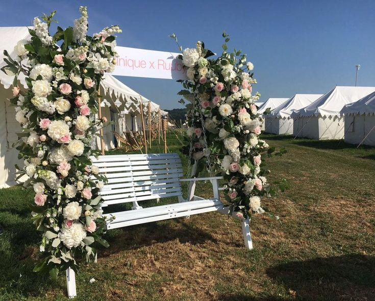 Clinique Swing, Glastonbury  Hanging installation at Camp Kerala , Glastonbury #grandirosa #clinique #glastonbury #londonflorist #floralinstallation #flowerinspo #luxuriousflowers #eventflorists