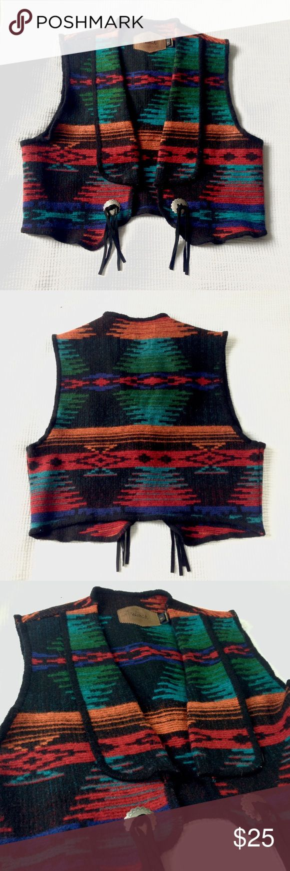 Woolrich Vintage Southwest Aztec Vest Woolrich Vintage Southwest Aztec Vest. Blended wool in vibrant ikat pattern in red, orange, green, blue, and teal on black background. Embellished silver button with black leather tassel decoration on front. Looks great with black pants and boots. This is a beautiful statement piece!   ---> Preowned in good condition. Slight wear as seen in photos. No holes, stains, or snags. Woolrich Jackets & Coats Vests