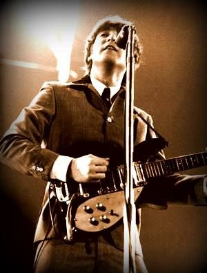 John onstage with his Rickenbacker 325