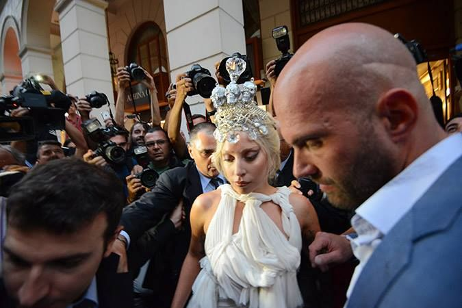Lady Gaga wears Kondylatos Jewellery Lady Gaga made fashion statement appearing outside hotel Grande Bretagne in Athens - Greece on Friday 19 of September wearing a crown made by Pericles Kondylatos. The international superstar chose this Skull crown made by Swarovski crystals, pearls & sculls  to complete her look as an alternative ancient Greek caryatid. A great honor for Greece and Pericles Kondylatos. The dress is also by a Greek designer Spyridon Tsagarakis.
