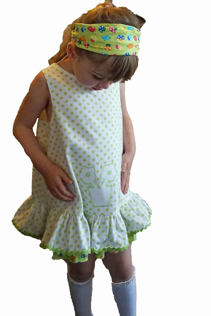 The Polly Playdress in cool, crisp white & green polka dot tones is a great little outfit for kindergarten, afternoon tea in town, or a playdate with special friends.  Easy to pop on and off; your little angel could manage this one herself.Constructed from 100% cotton - the outer layer was sourced in Paris - while the petticoat with contrasting frill is cotton lawn - very soft and comfortable to wear. It features three handmade appliqués on the front - two love hearts and a flower.  Truly…