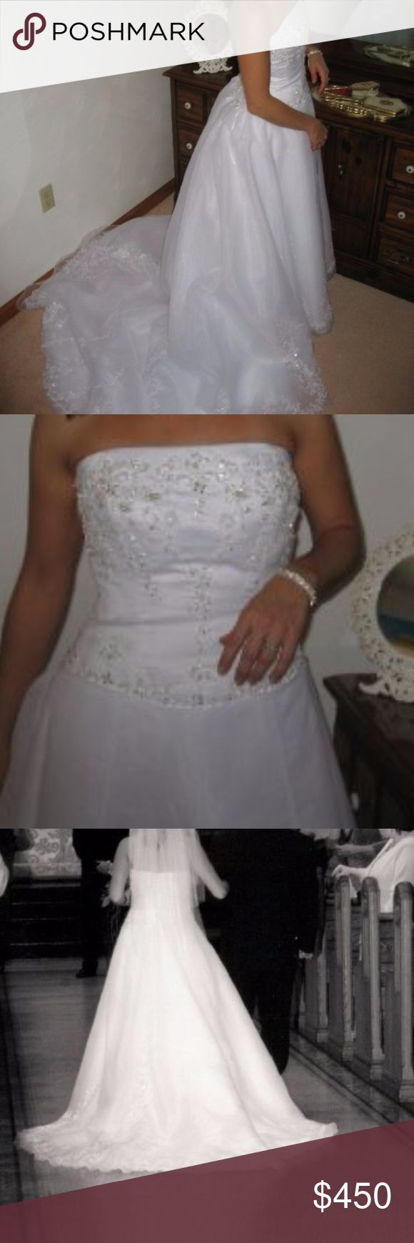 Casablanca Wedding Dress Beautiful Casablanca Wedding Gown. It's a size 10 that was taken in only at the top with ribbon tie bustles.  Pretty chiffon and lace appliques.  I has been professional cleaned and steamed. Casablanca Dresses Wedding