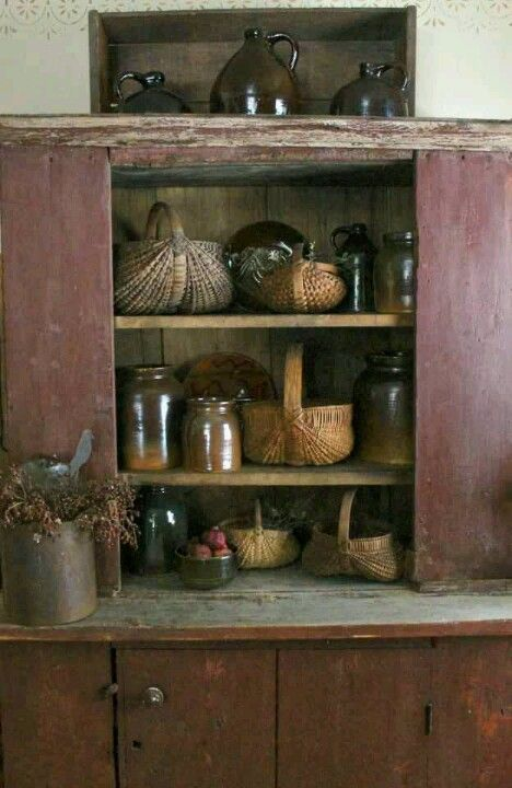 Old Primitive Cupboard...old brown crocks & baskets..would love this in my kitchen