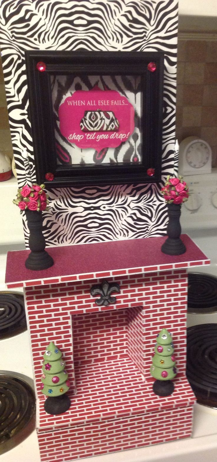I made this fireplace for my American Girl dollhouse. It is made of foam core and hot glue. I added the brick detail, which is the plastic sheets I purchased from Hobby Lobby. I put contact zebra print paper on the upper part. The contact paper works great for dollhouse wallpaper and it is very affordable. Fun project!