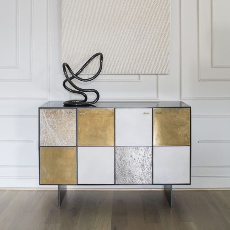 KELLY WEARSTLER   HUNTLEY CREDENZA. Blackened stainless steel body and solid walnut drawers and shelving