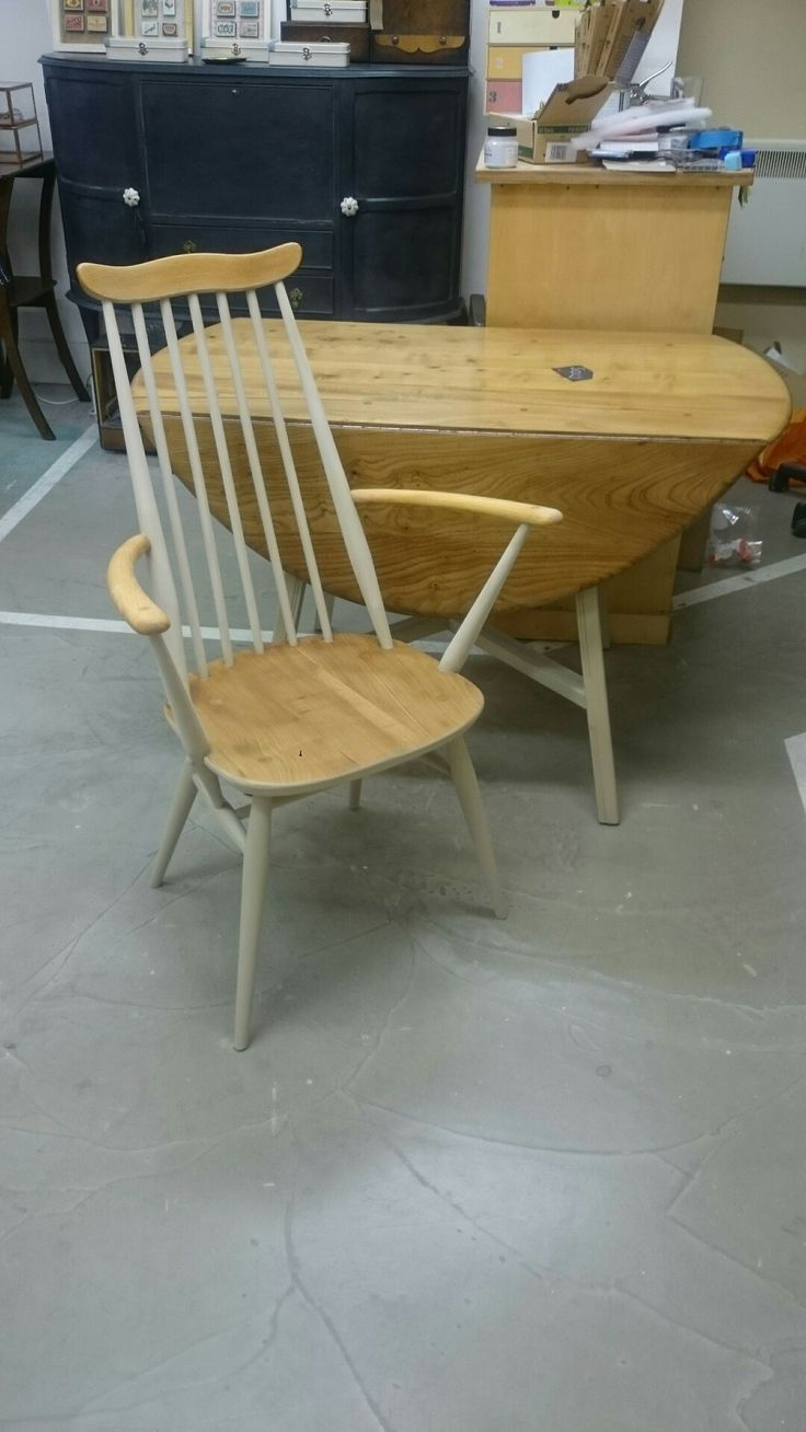 Ercol table and ercol Goldsmith carver.