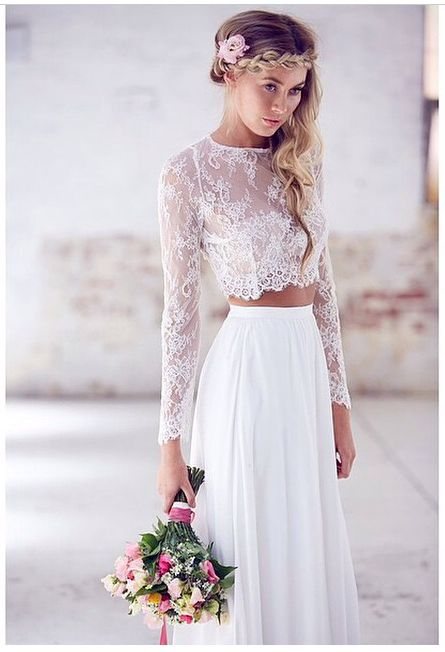 Boho bride with two piece outfit: cropped lace top and white skirt