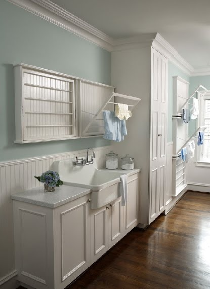 Laundry drying racks, beautiful large white laundry room, with custom pull down drying racks