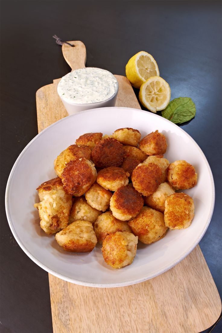 Easy Arancini with Crème Fraiche Herb Sauce make the perfect bite size snacks to enjoy while watching the game. http://gustotv.com/recipes/snacks/easy-arancini-creme-fraiche-herb-sauce/