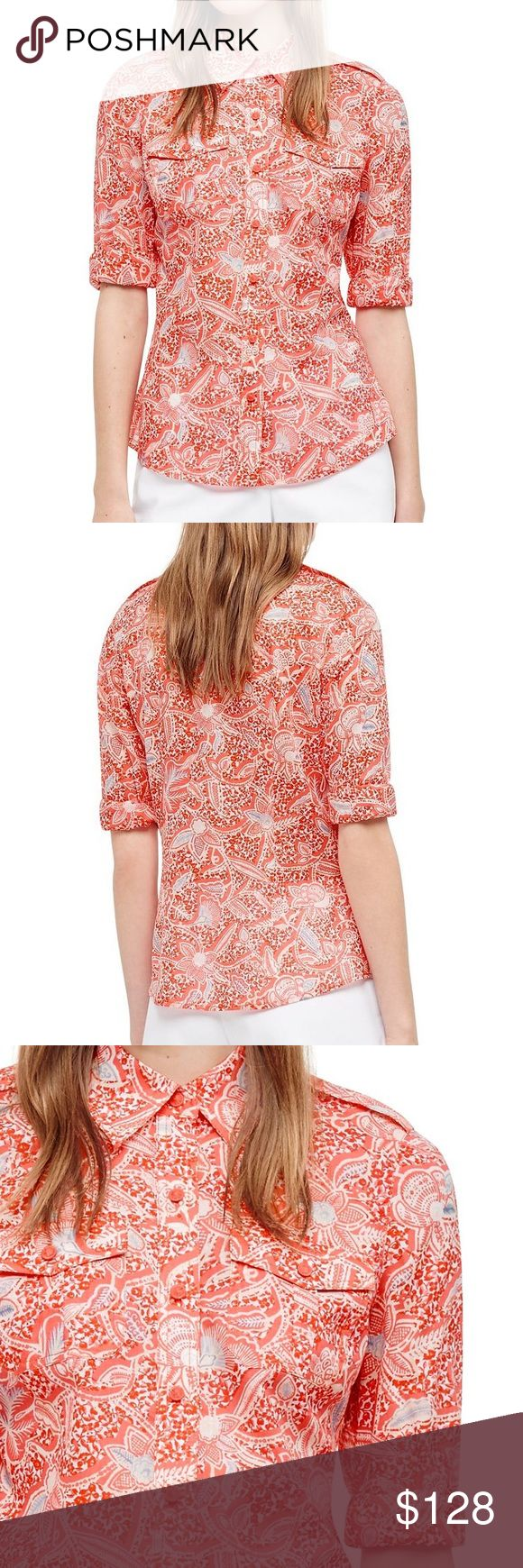 """Pink + White Melon Emmarentia Brigitte Blouse This Brigitte Blouse has a pretty mix of tropical blooms layered over small-scale flowers — a pattern inspired by an African wax print. A wardrobe classic, and one of Tory's signature styles, it's made of ultra-light cotton voile. Menswear-inspired but tailored, the fitted silhouette features safari details, including epaulettes and front flap pockets. Cotton. Length {25"""".} Item looks exactly as pictured. Offers always considered. Sold out item…"""