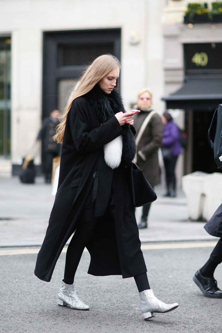 black long coat + shirt + skinny jeans + jacket + scarf + fur + sparkly glitter silver ankle boots