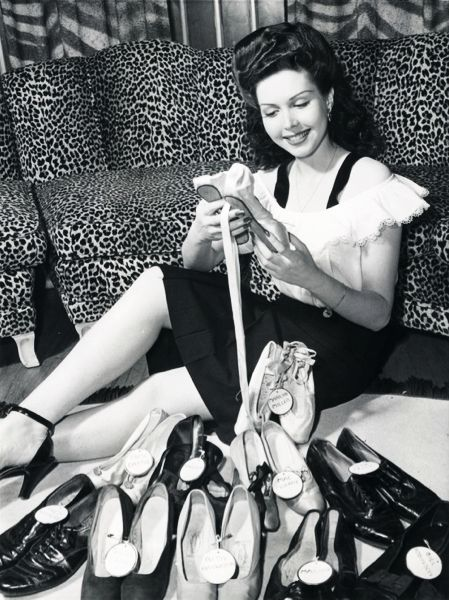 """vintagegal: """" Ann Miller and her collection of famous dancers shoes. (1944) Among famous names on her shoe collection are Nijinsky, Pavlova, Irene Castle, Rita Hayworth, Fred Astaire, Gilda Gray and Mae Murray. """""""