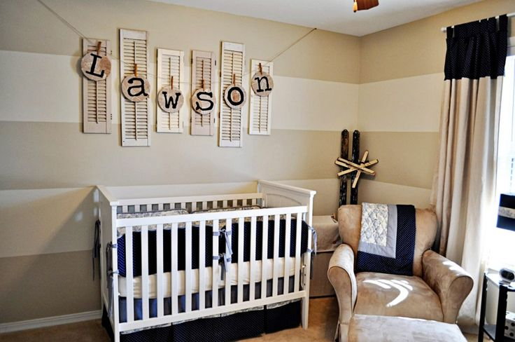 Cute nursery. Love the natural colors, the stripes on the walls, and the baby name on the wall. Very simple and classy!
