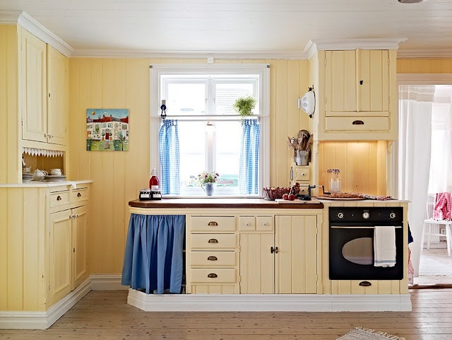 What if the cabinets matched the walls? Just a thought...