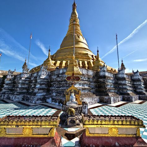 Aircraft contrails in the sky over  Lawkananda Pagoda in Sittwe, Myanmar.