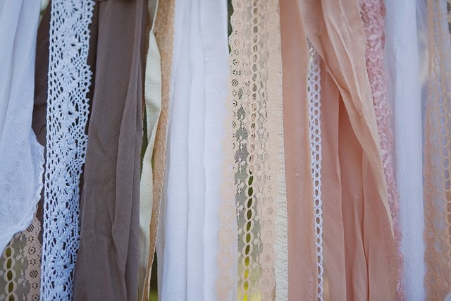use long pieces of pretty fabric/lace as photobooth background