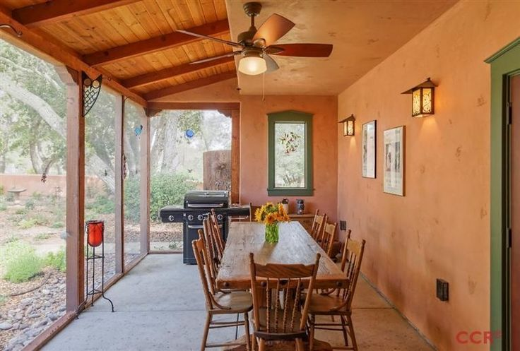 Southwestern Porch with Outdoor kitchen, Bird bath, Woodhaven Plank Wood Ceiling, Screened porch, Fence