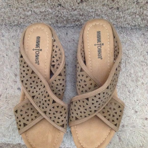 Minnetonka wedge sandals Tan wedge sandals size 7. Brand new, never worn. Nice sandal to set off any spring/summer outfit! Minnetonka Shoes Wedges