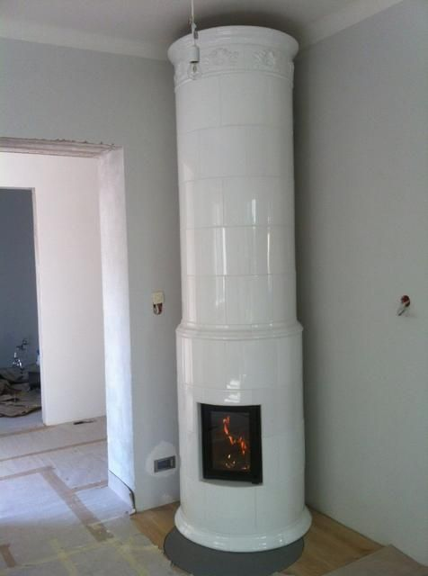 Tiled round stove ,Hand-made ceramic tiles from kaflarnia.com -manufactory with 125 years tradition.