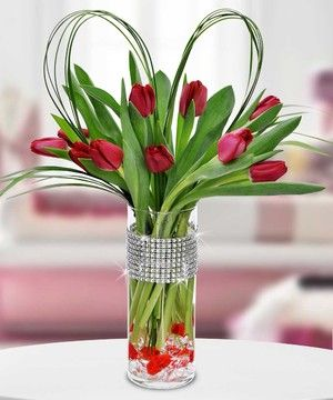 Beautiful Dutch tulips highlight this magnificent bouquet inside of a sparkling vase, accented with red and clear gemstones! by Beneva Flowers. #Sarasota